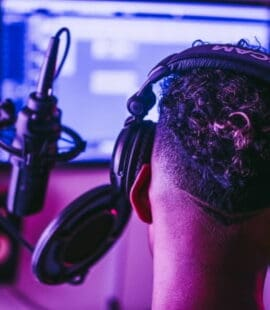 man in music studio with headphones on listening to exclusive beats